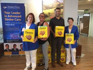 Bank of the Sierra and hospital staff pose next to donated Cheerios.
